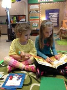 girls reading together- MCK